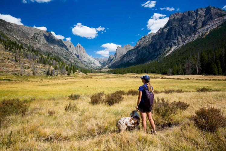 A woman and her dog admiring the view in Clear Creek Valley